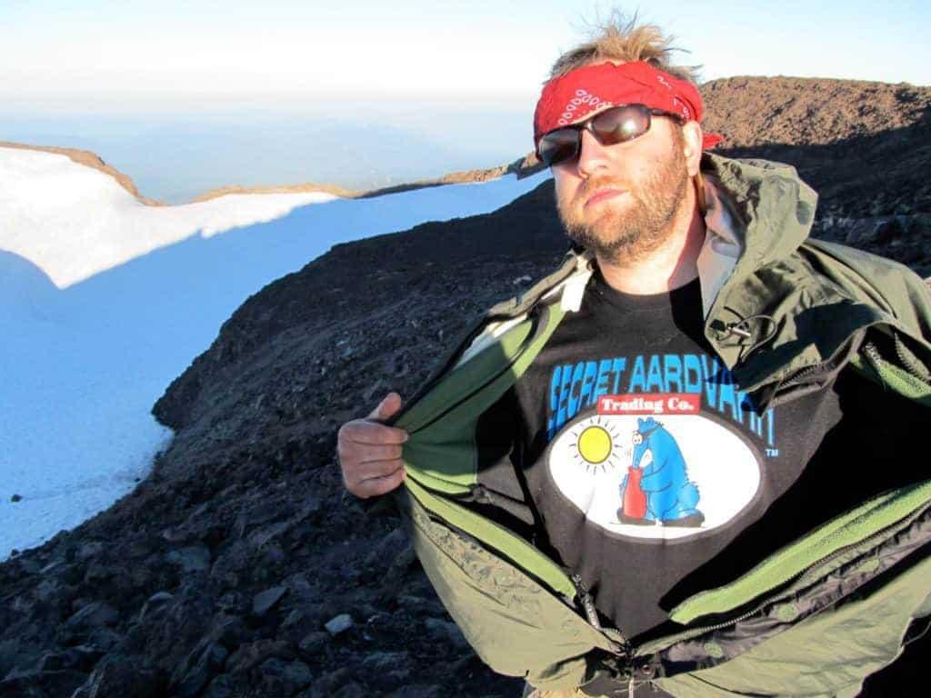 Rob wearing a secret aardvark t-shirt on top of a snowy mountain